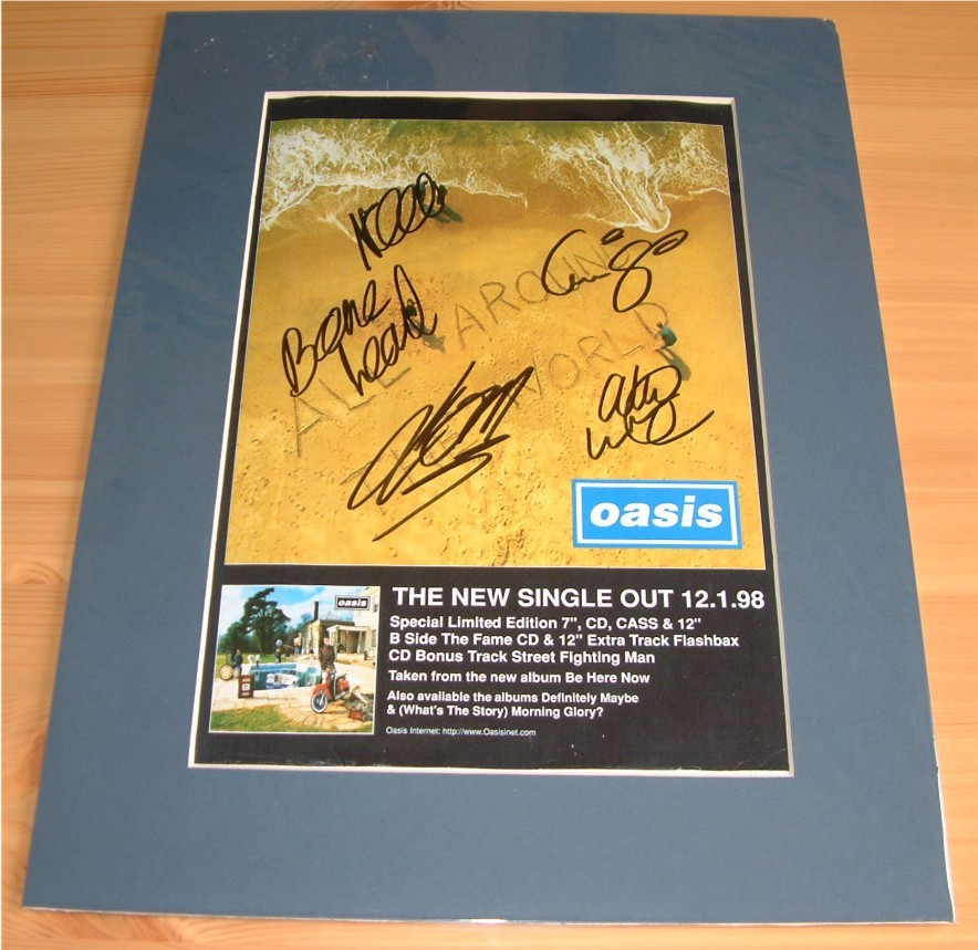 - GROUP SIGNED & MOUNTED MAG ADVERT PAGE -