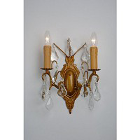 This is a stunning gold wall light with clear crystal droplets and candle style light bulb holders.