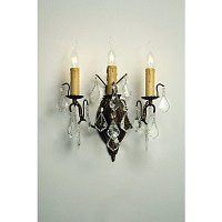 This is a stunning bronze wall light with clear crystal droplets and candle style light bulb holders