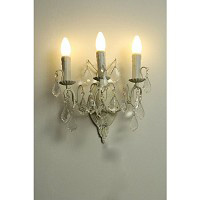 This is a stunning cream wall light with clear crystal droplets and candle style light bulb holders.