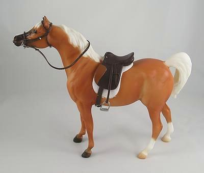This is a 1/12th Classic Scale Genuine Breyer Palomino Half Arab Stallion. He measures 6`H x 2`W x