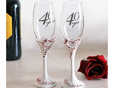 This gorgeous 40th Wedding Anniversary Pair of Heart Champagne Glasses would make the perfect gift for any special couple celebrating their ruby wedding anniversary.This set has two identical champagne flutes with the words 40 Years in silver writing