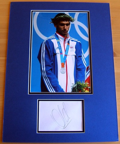 Signed by the Olympic Silver Medallist in black pen. Certificate Of Authenticity no. 0470000047