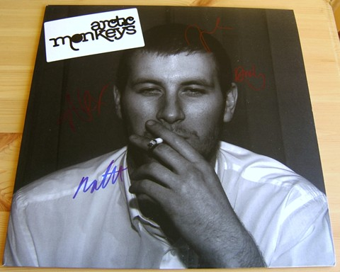 The Arctic Monkeys debut LP ``Whatever People Say I Am  That`s What I`m Not`` signed on the front