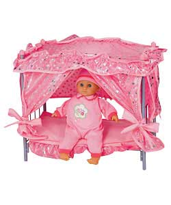 Canopy doll bed including a 38cm soft baby. Baby can speak 4 phases, press the tummy she says Mama,