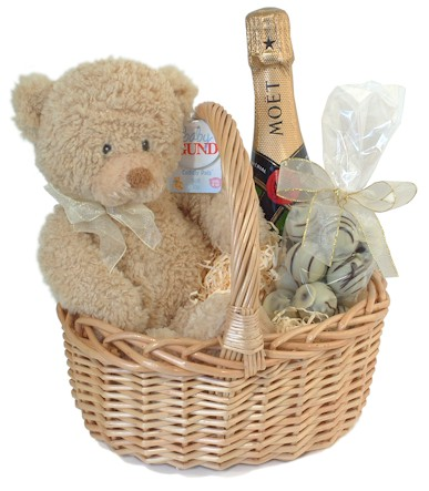 Isn`t this the most delightful little baby gift basket? The adorable baby bear by Gund Bears wears