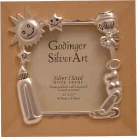 A beautiful satin finish silver plated wooden baby photo frame. A great way to display your