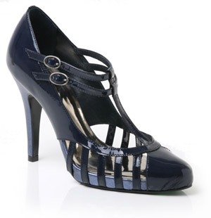 Patent leather court shoe featuring cut out detail and two buckled T-bar straps. With its high stile