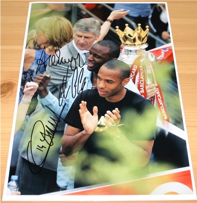 Great A4 photograph signed by Arsene Wenger  Patrick Vieira and Thierry Henry in black pen. COA -