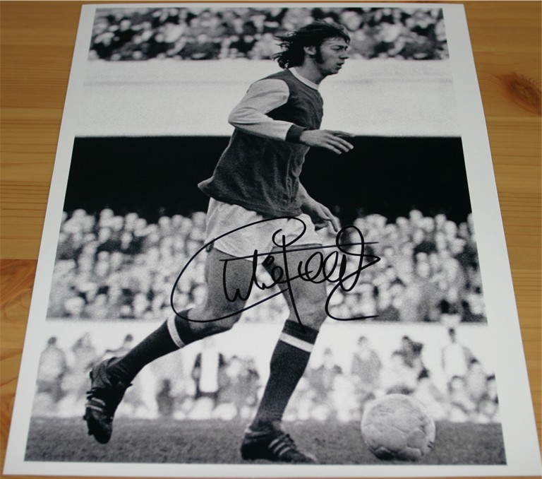Signed clearly in black pen by the Arsenal legend Charlie George. COA - 0420000243