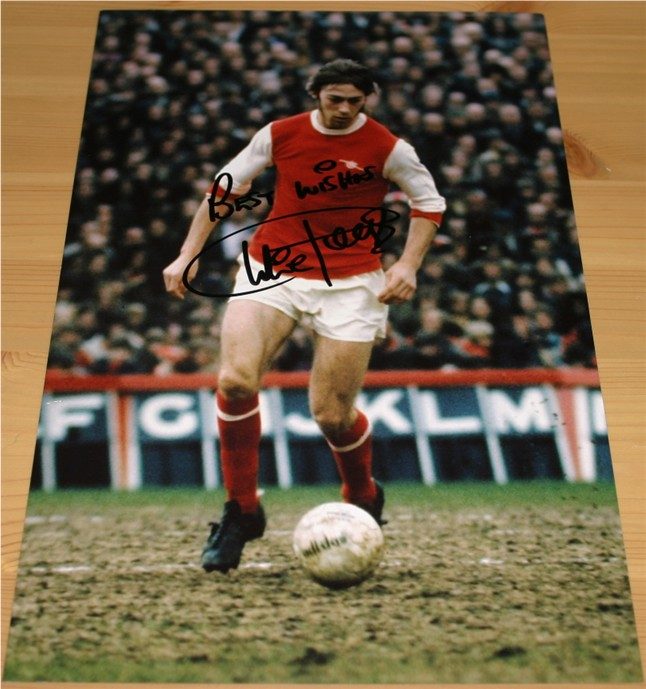 Signed clearly in black pen by the Arsenal legend Charlie George. COA - 0420000036