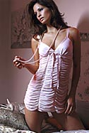 An ultra girly ruffle and ribbon babydoll and matching ruched thong with back