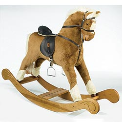 Rocking horse on a stylised ornate wooden bow rocker. Features soft padded saddle, reins and