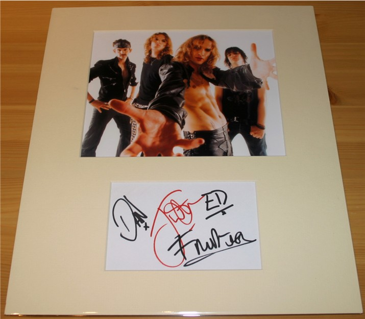 The signatures of Justin  Dan  Ed and Frankie from the massive British rock band The Darkness