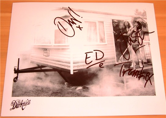Black and white promotional photograph signed by Justin  Dan  Ed and Frankie from the massive