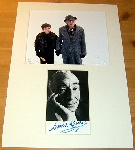 Signed photograph of David Kelly mounted alongside another colour photograph from the movie Charlie