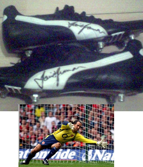 This is a pair of black and white puma studded football boot which were worn by Arsenal keeper