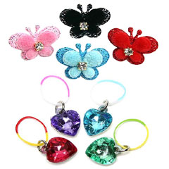 Accessorize your pooch with glitzy hearts or adorable sparkly butterfly hair bands.  The glitzy hear