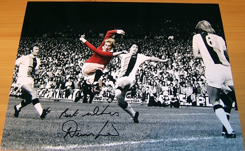 Exceptional glossy colour photograph signed by Denis Law. Certificate Of Authenticity no