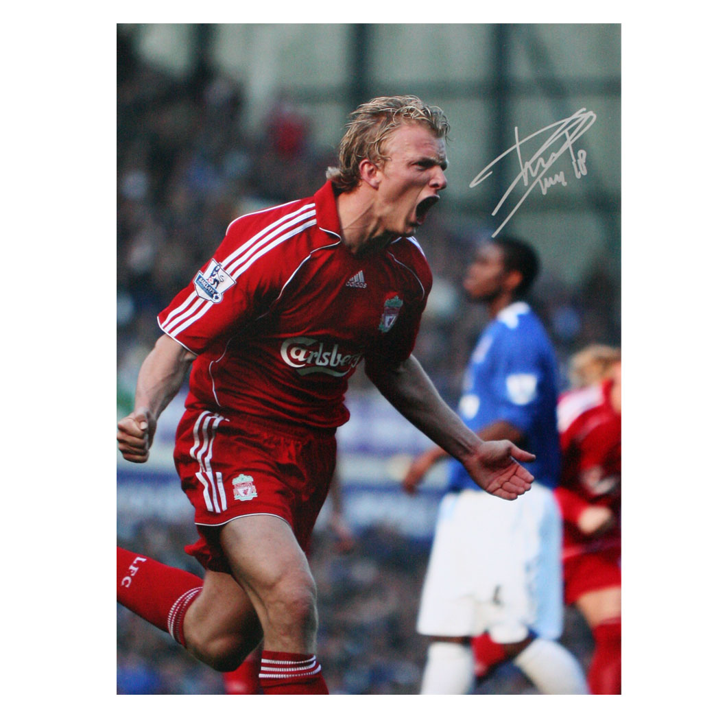 This photograph shows Dirk Kuyt celebrating after scoring a goal against Everton at Goodison. With a