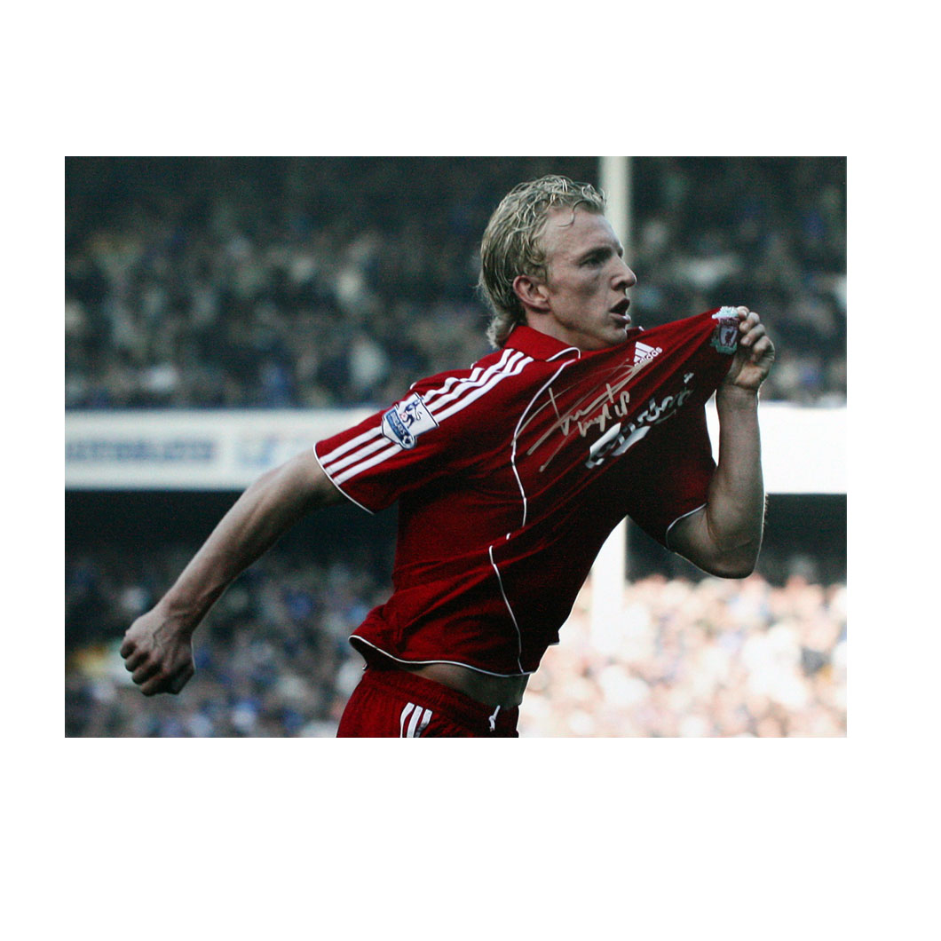 This photograph shows Dirk Kuyt celebrating his second goal in the Merseyside derby at Everton.  Kuy