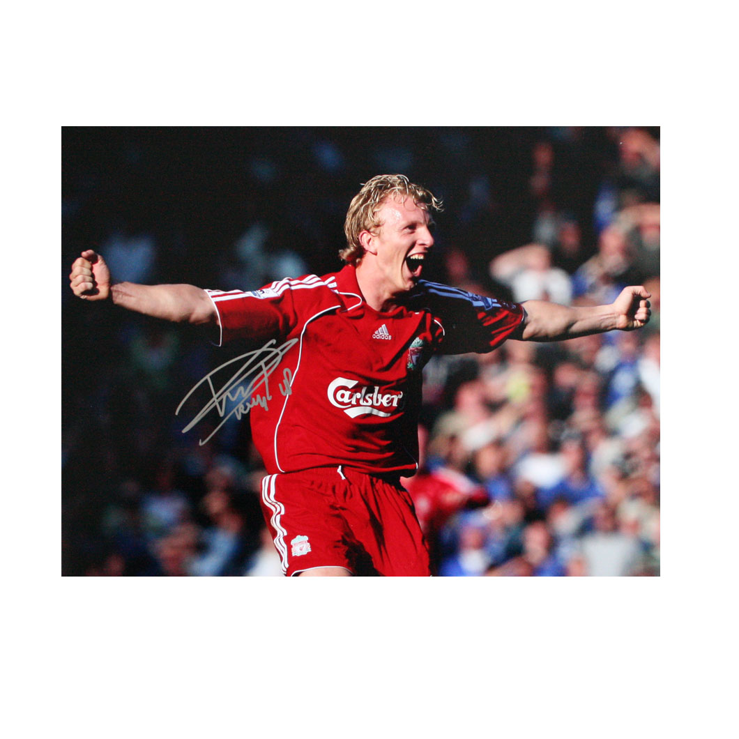 This photo shows Dirk Kuyt celebrating at the final whistle after scoring the winning goal from the