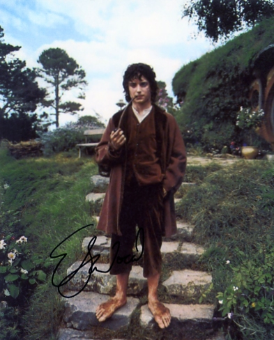 Signed by Elijah Wood in blue pen. Certificate of Authenticity no. 0100000475