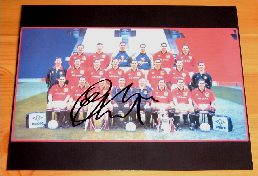 Eric Cantona has signed this superb photo in black pen. The picture shows the Manchester United