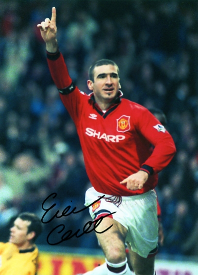 Eric Cantona has signed this superb glossy colour photograph in black pen. Certificate Of