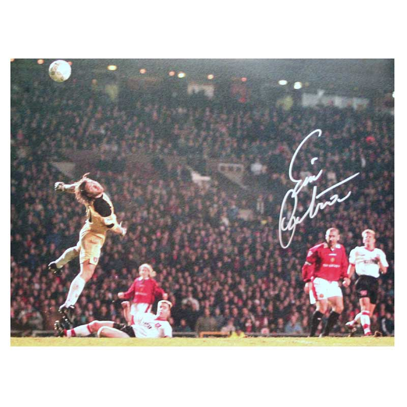 This photograph shows Manchester United legend Eric Cantona scoring his incredible chip against Sund