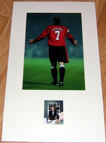 Eric Cantona has signed this small picture of him with the PFA Player of the Year Award in 1994