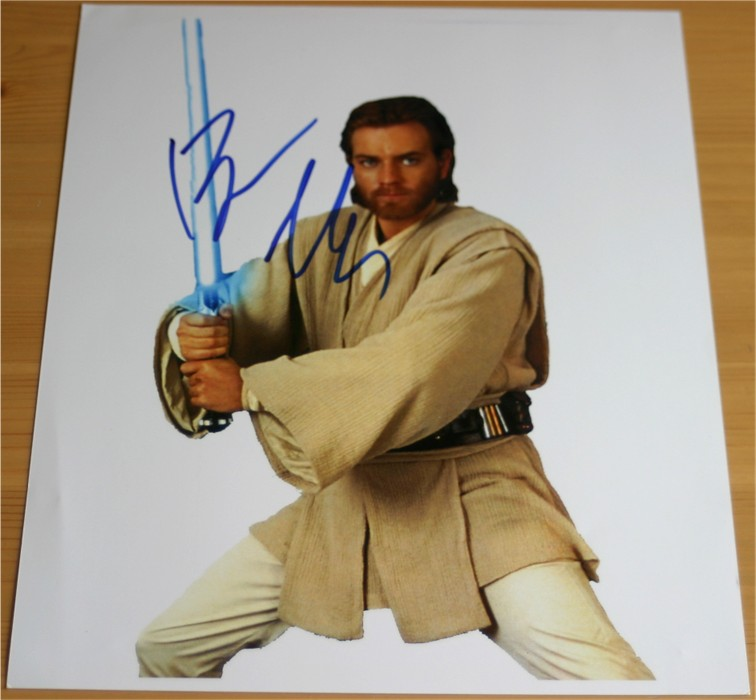 Quality colour photograph of the Star Wars cast which has been signed in blue pen by Ewan McGregor