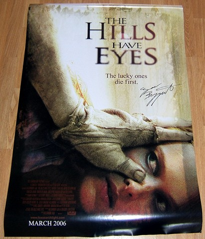 A full sized movie poster from the 2006 movie `The Hills Have Eyes` signed by Ezra Buzzington