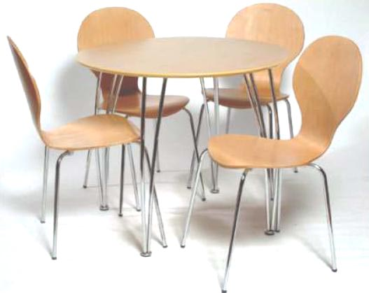 An attractive chrome and beech circular dining table with four moulded dining chairs.   A great