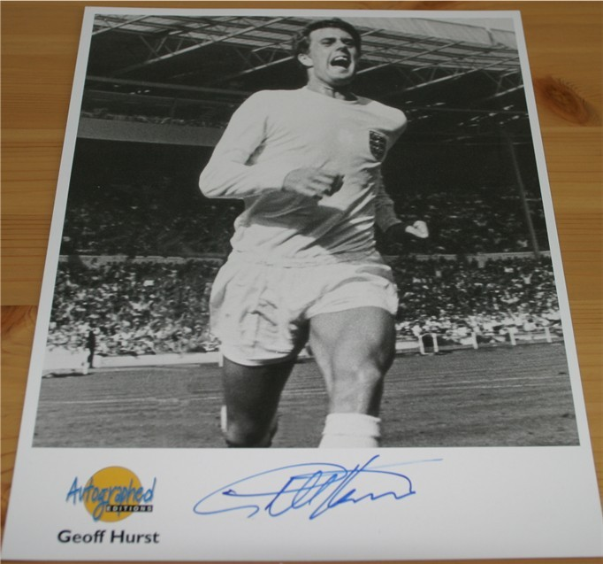 Autographed Editions photo signed in blue pen by the England World Cup winning star Sir Geoff Hurst