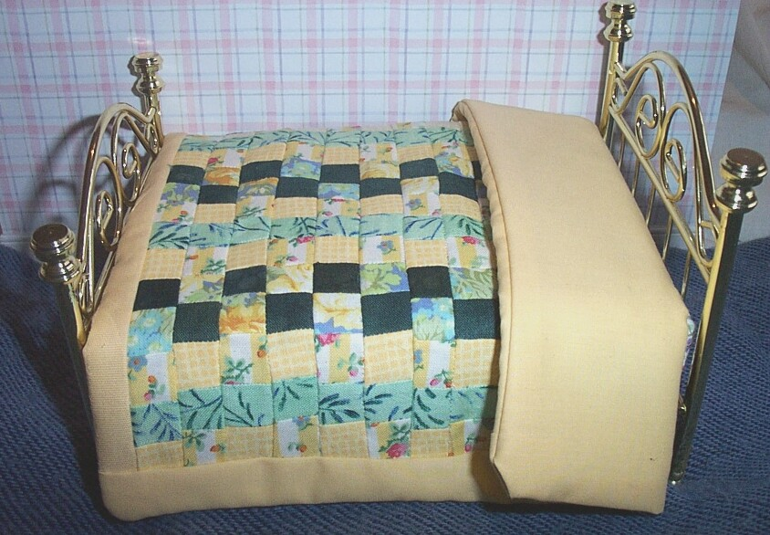 This is a genuine handmade patchwork quilt made especially for The Dolls House Store by Sally