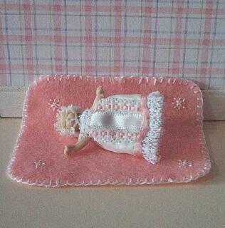This delightful little 1:12 scale pink baby blanket is handmade exclusively for us by Sally