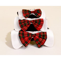 A fashionable plaid bow tie on white tabs completes the ultimate holiday pet fashion accessory to ma