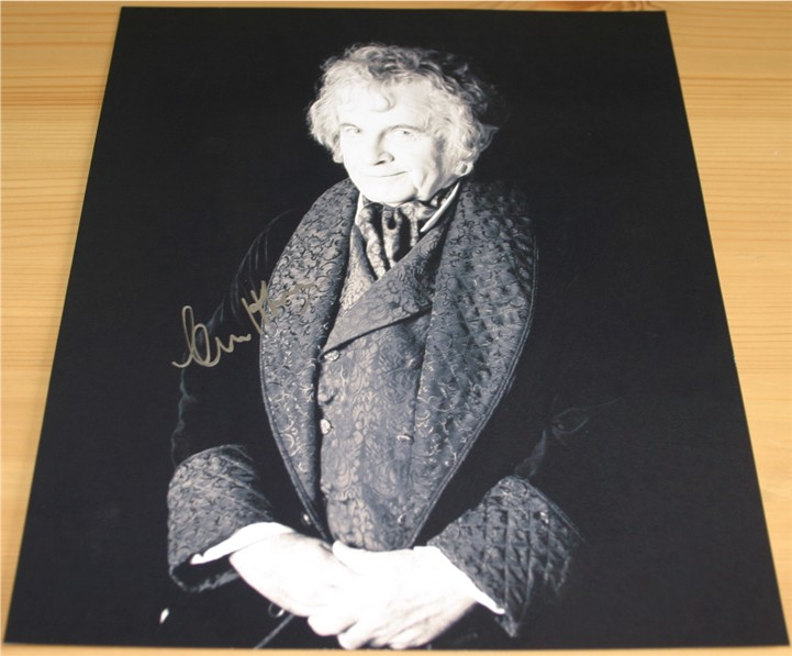 Superb signed photo of Ian Holm - Bilbo in Lord of the Rings. Signed in silver pen. COA -