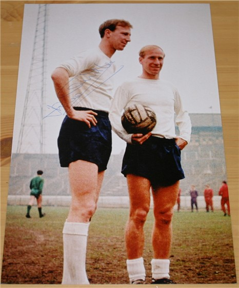 Signed in blue pen by Jack Charlton (pictured with his brother Bobby). COA - 0420000450