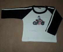 White top with motorbike print on the front. Navy