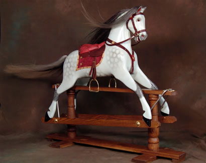 This exquisite hand-made rocking horse will provide years of fun for the both the young and the