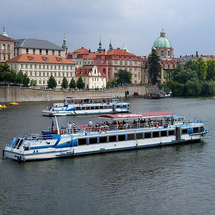 Enjoy a relaxing sightseeing cruise along the Vltava River where you can admire the scenic views alo