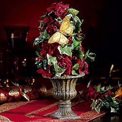 Deep red roses and ivy make up these delightful decorations adorned with a golden butterfly