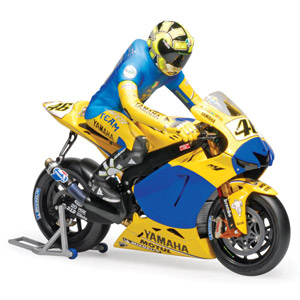 Minichamps has released a 1/12 riding figure of Valentino Rossi depecting the moment when he wore th