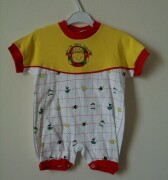 Red, white and yellow romper with popper fastening