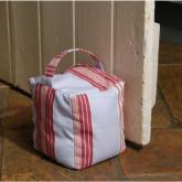 Let the summer breeze in and stop doors banging with this chunky and colourful cotton doorstop. Comp