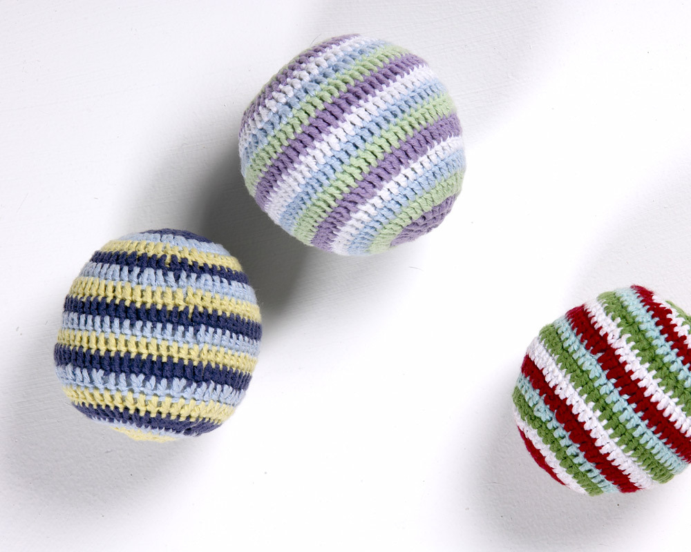These adorable, hand-knitted, 100 cotton rattles will delight your baby! Made by women living and wo