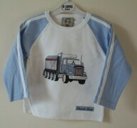 White top with blue truck print on the front and ""