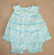Lovely little sleeveless sundress with matching pants in turquoise blue wit